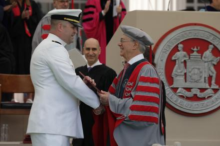 President Reif hands a diploma to one of MIT's newest alumni